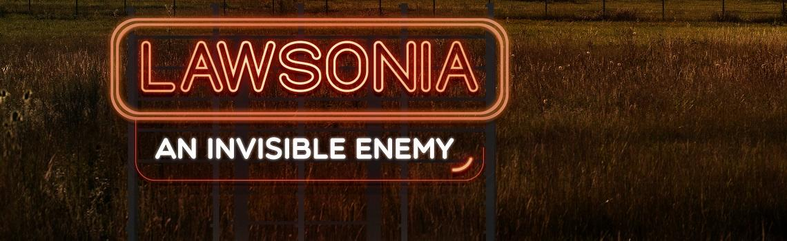 """Image of a sign """"Lawsonia an invisible enemy"""" in a field"""