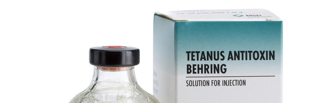 Image of Tetanus Antitoxin Behring bottle next to it's cardboard carton