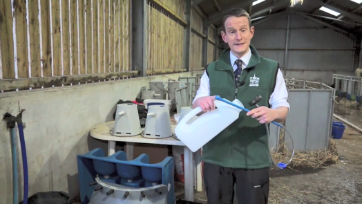Image of vet advising how to clean colostrum feeders